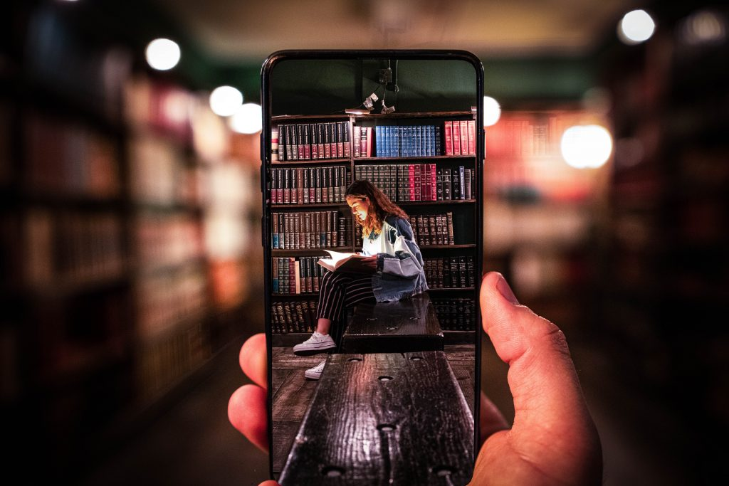 The Last Bookstore dtla los angeles picture phone girl reading book