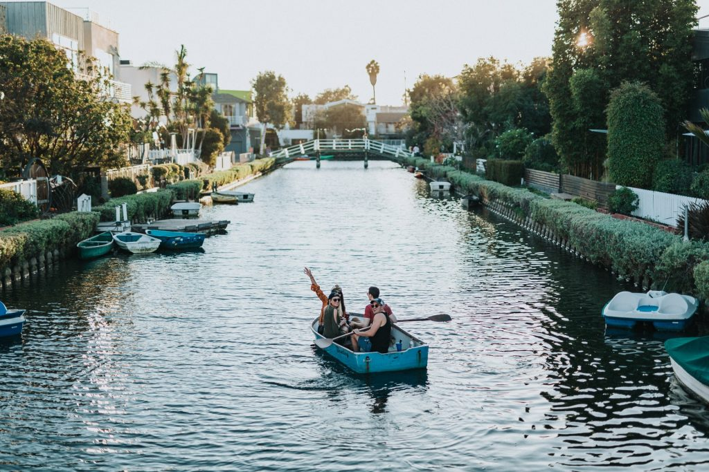 guys on boats bros being boys on venice canal los angeles moat