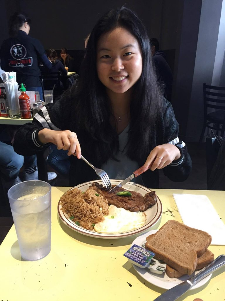 karen eating steak and rice with eggs fork and knife plate