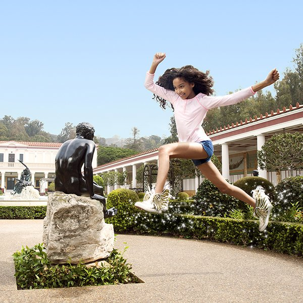 girl jumping with wing shoes randomly getty villa