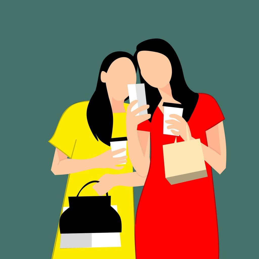 women coffee looking at phones