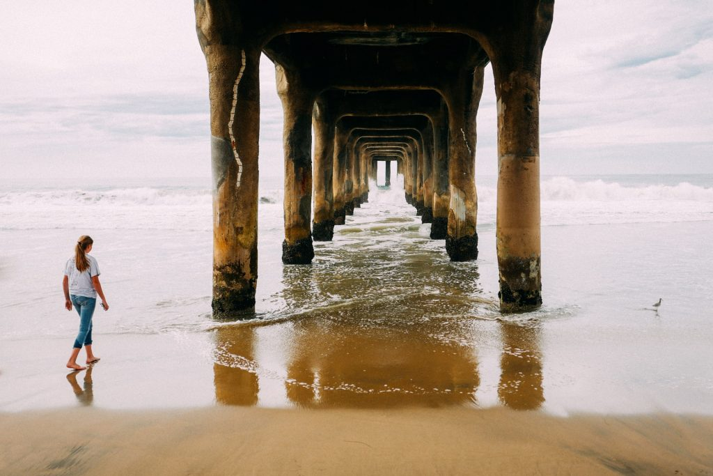 manhattan beach pier woman walking underneath picture example