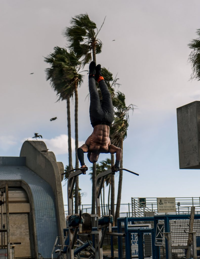 muscle beach really buff guy doing exercises venice los angeles