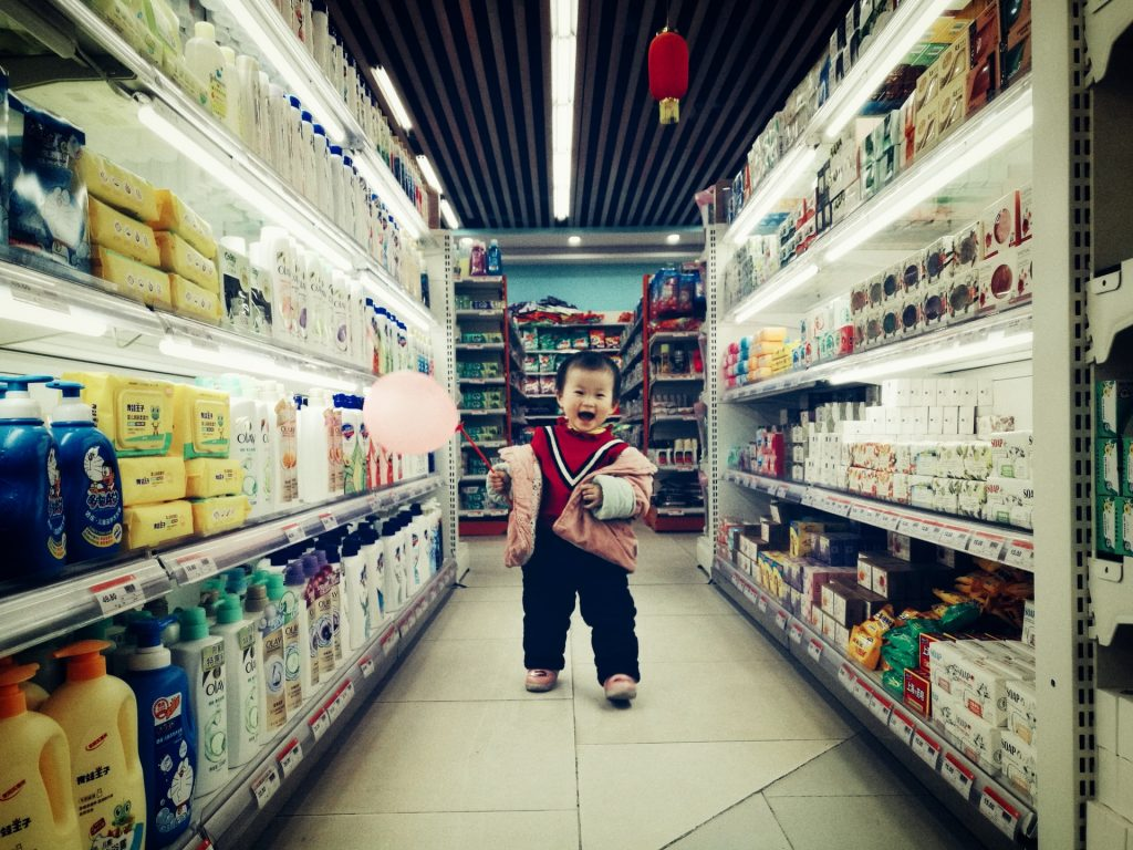 happy kid asian grocery aisle